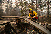 Tyson Wellington, a member of Hillsboro Fire & Rescue, looks for survivors in cars that were affected in the Camp Fire in Paradise, Saturday, November 10, 2018.