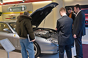 Moscow, Russia, 04/03/2006.&#xA;Salesmen and customers in the Ferrari showroom, part of the central Moscow complex of luxury stores controlled by the Russian Mercury Group.<br />