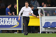 AFC Wimbledon manager Neal Ardley walking off the pitch during the EFL Sky Bet League 1 match between AFC Wimbledon and Oldham Athletic at the Cherry Red Records Stadium, Kingston, England on 21 April 2018. Picture by Matthew Redman.
