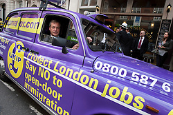 © licensed to London News Pictures. London, UK 12/04/2012. UKIP Leader Nigel Farage posing inside the UKIP branded cab at the launch of London Mayoral election campaign for UKIP. UKIP announced Lawrence Webb as their Mayoral candidate and the campaign is backed by long term Tory supporter Peter Stringfellow. Photo credit: Tolga Akmen/LNP