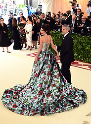 Amal and George Clooney attending the Metropolitan Museum of Art Costume Institute Benefit Gala 2018 in New York, USA.
