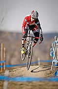 SHOT 1/12/14 1:58:33 PM - Jake Wells (#27) of Avon, Co. catches air off a small jump while warming up for the Men's Elite race at the 2014 USA Cycling Cyclo-Cross National Championships at Valmont Bike Park in Boulder, Co.  (Photo by Marc Piscotty / © 2014)
