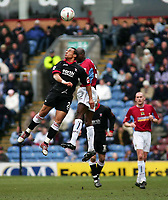 Photo. Andrew Unwin.<br /> Burnley v Rotherham, Coca-Cola Championship, Turf Moor, Burnley 12/03/2005.<br /> Rotherham's Leandre Griffit (L) rises above Burnley's Mo Camara (R) to win an aerial ball.