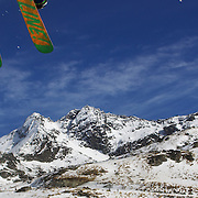 A skier takes to the air at The Remarkables Ski Fields, Queenstown, New Zealand during a session with 'The Air Bag'  a large inflatable airbag which breaks the fall of the participant on landing and allows valuable experience and a training aid for Aerial skiers and snowboarders. Queenstown, South Island, New Zealand, 23rd July 2011