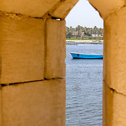 Looking out on the Nile from the defences of the Fort of Qaitbey near Rashid, Egypt.