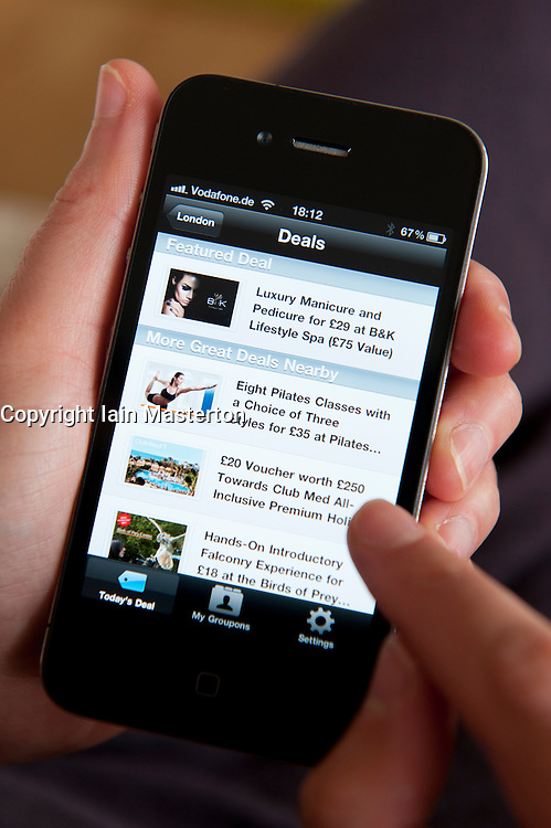 Groupon app showing deals in London on an  iPhone 4G smart phone
