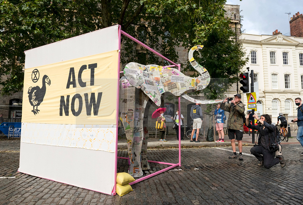 """© Licensed to London News Pictures;28/08/2020; Bristol, UK. Extinction Rebellion set up an """"Elephant in the Room"""" artwork to block Prince Street bridge in Bristol Harbourside as the first day of a bank holiday weekend of protest action titled """"Bristol Rebellion: We Want To Live"""". XR are protesting in Bristol and other cities in the UK against climate change, leading up to a protest in London starting on 01 September. XR say that despite clear scientific evidence of the deadly climate and ecological emergency, the UK government are refusing to take the urgent action needed to avoid mass extinction. XR say we need politicians to support the Climate and Ecological Emergency Bill. During the coronavirus covid-19 pandemic, climate change is being forgotten but it is still an emergency that is happening, the elephant in the room. Photo credit: Simon Chapman/LNP."""