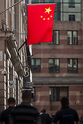 The Chinese national flag hangs together, on 15th August 2016 in the City of London, UK. Seen overhead of Londoners with the offices of banks and financial institutions on this narrow side street, medieval in history and in the oldest district of the capital, founded by the Romans in the 1st Century, it symbolises the presence of Sino investment in the UK.