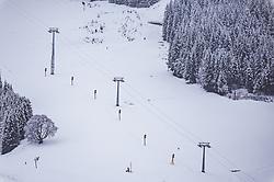 THEMENBILD - Schneekanonen und Skiliftstützen auf einer Skipiste. Die Vorbereitungen für die neue Skisaison laufen auf Hochtouren, aufgenommen am 12. November 2019, Saalbach Hinterglemm, Österreich // Snow cannons on a snowed skislope. Preparations for the new ski season are in full swing on 2019/11/12, Saalbach Hinterglemm, Austria. EXPA Pictures © 2019, PhotoCredit: EXPA/ Stefanie Oberhauser