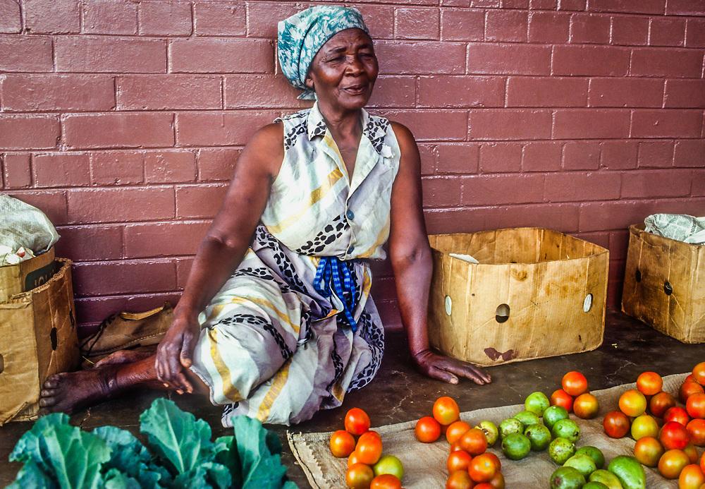Selling tomatoes, local market, Zimbabwe