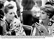 Christy Turlington and Linda Evangelista backstage before the Valentino show. Paris couture. July 1991. Film91877f19<br />© Copyright Photograph by Dafydd Jones<br />66 Stockwell Park Rd. London SW9 0DA<br />Tel 0171 733 0108