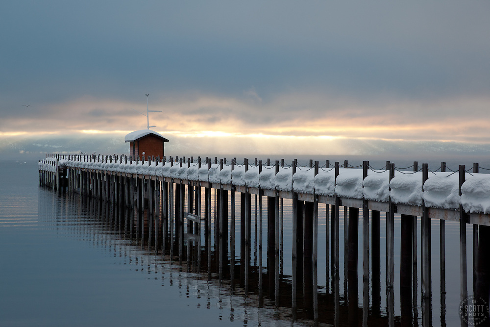 """""""Snowy Pier in Tahoe City 2"""" - This snow covered pier and two flying birds were photographed in the early morning near Commons Beach in Tahoe City, CA."""