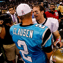 October 3, 2010; New Orleans, LA, USA; New Orleans Saints quarterback Drew Brees (9) talks to Carolina Panthers quarterback Jimmy Clausen (2) following a game at the Louisiana Superdome. The Saints defeated the Panthers 16-14. Mandatory Credit: Derick E. Hingle
