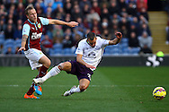 Everton's Leon Osman (c) tackles Burnley's Scott Arfield. Barclays Premier league match, Burnley v Everton at Turf Moor in Burnley, Lancs on Sunday 26th October 2014.<br /> pic by Chris Stading, Andrew Orchard sports photography.