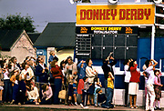A crowd watching from the donkey derby field the arrival of the marines by parachute as they visited Butlins holiday camp Skegness, giving a disply to the crowd and encouraging recruitment during the Falklands war. Butlins Skegness is a holiday camp located in Ingoldmells near Skegness in Lincolnshire. Sir William Butlin conceived of its creation based on his experiences at a Canadian summer camp in his youth and by observation of the actions of other holiday accommodation providers, both in seaside resort lodging houses and in earlier smaller holiday campsThe camp began opened in 1936, when it quickly proved to be a success with a need for expansion. The camp included dining and recreation facilities, such as dance halls and sports fields. Over the past 75 years the camp has seen continuous use and development, in the mid-1980s and again in the late 1990s being subject to substantial investment and redevelopment. In the late 1990s the site was re-branded as a holiday resort, and remains open today as one of three remaining Butlins resorts.