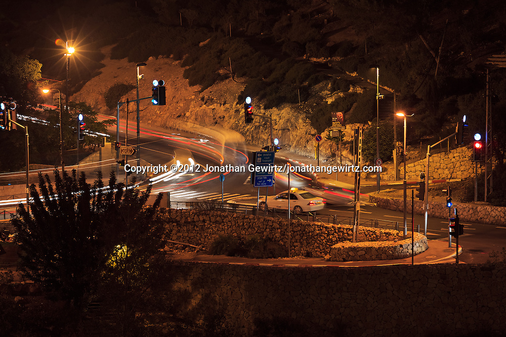 Night view of the intersection of Derech Hevron, Ma'ale Hashalom and Hativat Yerushalayim streets, at the base of Mount Zion and the western walls of Jerusalem's Old City. WATERMARKS WILL NOT APPEAR ON PRINTS OR LICENSED IMAGES.