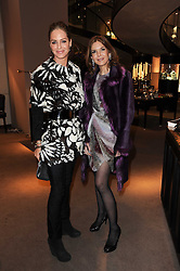 Left to right, TRINNY WOODALL and KIM ROBSON-ORTIZ at a party to celebrate the publication of Nathalie von Bismarck's book 'Invisible' held at Asprey, 167 New Bond Street, London on 9th December 2010.