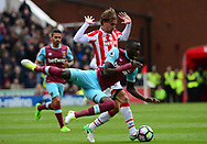 Marc Munisea of Stoke battles with Cheikhou Kouyate OF West Ham.  Premier league match, Stoke City v West Ham Utd at the Bet365 Stadium in Stoke on Trent, Staffs on Saturday 29th April 2017.<br /> pic by Bradley Collyer, Andrew Orchard sports photography.