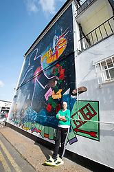 A 9 metre George Michael mural painted in Kingsbury by artist Dawn Mellor, North West London, Great Britain <br />Unveiled 17th September 2020    <br /><br />Artist Dawn Mellor with at her large-scale mural that celebrates the life of local hero George Michael who was a 1st year pupil at Kingsbury High School in 1974. <br />Commissioned as part of the Brent supported by the Brent Borough of Culture 2020 fund. <br /><br />Photograph by Elliott Franks