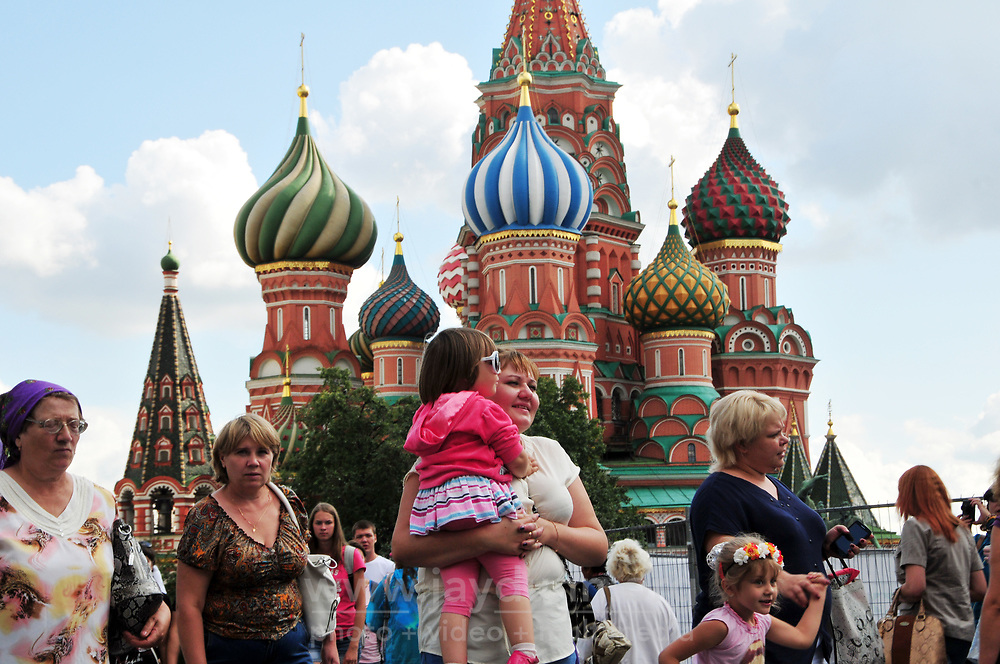 Tourists stream through Red Square in Moscow with St. Basil's Cathedral in the background. The structure, now a museum, was built in the mid-1500's. Part of the Kremlin and Red Square UNESCO World Heritage site, the cathedral is without a doubt the most recognizable Orthodox Christian church in the world.