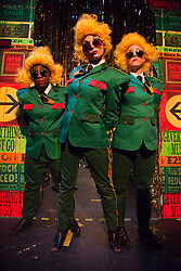 """© Licensed to London News Pictures. 14/12/2011. London, UK. Performers: H Plewis, Sarah Fielding and Azara Meghie. Theatre collective """"Duckie"""" returns to the Barbican for their """"Copyright Christmas"""" promenade performance show (10 to 31 December 2011). With capitalism collapsing and the criminal economy taking over, there has never been a better time to go shopping to witness the decaying arcades of branded Britain. Photo credit: Bettina Strenske/LNP"""