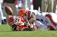 KANSAS CITY, MO - OCTOBER 27:  Defensive back Buster Skrine (top) of the Cleveland Browns knocks the ball loss from wide receiver Dexter McCluster (bottom) of the Kansas City Chiefs during the first half on October 27, 2013 at Arrowhead Stadium in Kansas City, Missouri.  Kansas City won 23-17. (Photo by Peter Aiken/Getty Images) *** Local Caption *** Buster Skrine;Dexter McCluster