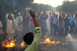 October 31, 2018 - Lahore, Punjab, Pakistan - Pakistani supporters of Tehreek-e-Labaik Ya Rasool Allah (TLY) a hard line religious political party and other workers of religious parties chant slogans during a protest against the supreme court decision to overturn the conviction of Christian woman Asia Bibi in Lahore. Pakistan's Supreme Court on October 31 overturned the conviction of Asia Bibi, a Christian mother facing execution for blasphemy, in a landmark case which has incited deadly violence and reached as far as the Vatican. (Credit Image: © Rana Sajid Hussain/Pacific Press via ZUMA Wire)