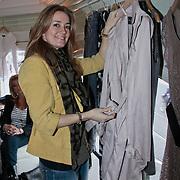 NLD/Amsterdam/20110228 - Presentatie Mama Licious, Monique Verkaart showt de kleding van mama licious