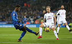 Leicester City's Demarai Gray (left) and Burnley's Scott Arfield battle for the ball