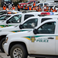Emergency personnel and other staff observe an active shooter police training exercise at the Navajo Area Office Indian Health Services in St Michaels Thursday.