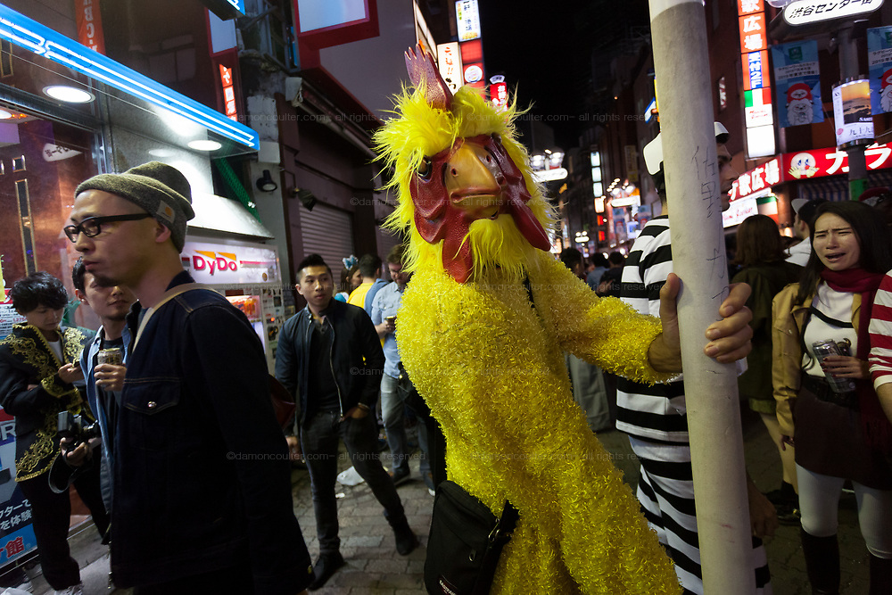 A man dressed as a big chicken during the Halloween celebrations Shibuya, Tokyo, Japan. Saturday October 27th 2018. The celebrations marking this event have grown in popularity in Japan recently. Enjoyed mostly by young adults who like to dress up, drink , dance and misbehave in parts of Tokyo like Shibuya and Roppongi. There has been a push back from Japanese society and the police to try to limit the bad behaviour.