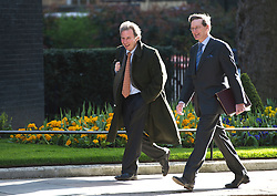 © London News Pictures. 23/04/2013. London, UK.    Oliver Letwin (left) and Attorney General Dominic Grieve (right)  on Downing Street in London for cabinet meeting. Photo credit: Ben Cawthra/LNP.