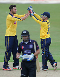 James Vince of Hampshire celebrates with Adam Wheater of Hampshire after Geraint Jones of Gloucestershire is bowled out  - Photo mandatory by-line: Dougie Allward/JMP - Mobile: 07966 386802 - 14/07/2015 - SPORT - Cricket - Cheltenham - Cheltenham College - Natwest T20 Blast