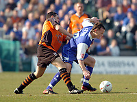 Photo. Leigh Quinnell.  Gillingham v Ipswich Town Coca Cola championship. 24/01/2005.Tommy Miller battles with Gillinghams Michael Flynn for the ball.