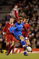 Photo. Jed Wee.<br /> Liverpool v Levski Sofia, UEFA Cup, Anfield, Liverpool. 26/02/2004.<br /> Sofia's Elin Topuzakov (L) holds Liverpool's Steven Gerrard at bay.