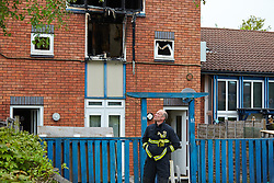 © Licensed to London News Pictures.  20/05/2013. MILTON KEYNES, UK. Fire fighters remain at the scene of a fatal house fire in St Leger Court, Great Lindford, Milton Keynes. Police were called at 7.58pm last night (19/5) by Buckinghamshire Fire and Rescue Service to a fire at a residential address where an occupant died. A 57-year-old man has been arrested on suspicion of murder and remains in custody. Photo credit: Cliff Hide/LNP