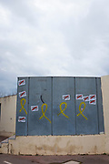 """Pro-Catalan independence graffiti and stickers, on the wall of the Biblioteca Central Gabriel Ferrater (municipal library) Sant Cugat del Valles, Barcelona, Catalonia.<br /> """"Llibertat Presos Politics"""" is Catalan for """"free political prisoners"""", while the yellow ribbon signifies solidarity with the politicians and civic leaders who were held, or are being held in Spanish prisons.  One resident of Sant Cugat, Catalan Foreign Minister Raul Romeva, was amongst those jailed."""
