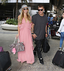 August 25, 2017 - Los Angeles, California, USA - 8/25/17.Paris Hilton and Chris Zylka are seen at LAX Airport in Los Angeles, CA. (Credit Image: © Starmax/Newscom via ZUMA Press)