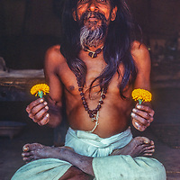 A local Hindu mystic and Aruvedic doctors poses in his hut in the Marsyandi River Valley, Nepal