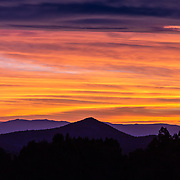 Rich color fills the sky over central Nevada at sunset. This view from nearly 10,000 feet shows distant peaks and ranges with a visual distance of over 60 miles of open country. Traveling and camping in this kind of territory restores the soul and brings personal peace. 2nd Annual Great Nevada Exploratory Photographic Expedition - 2014