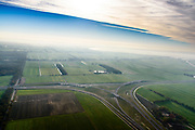 Nederland, Friesland, Joure, 04-11-2018; het nieuwe knooppunt Joure (kruising A6 met A7) ) vervangt het oude verkeersplein. Restanten van het zandlichamen van de oude rotonde nog zichtbaar.<br /> The new junction Joure replaces the old traffic square.<br /> luchtfoto (toeslag op standaard tarieven);<br /> aerial photo (additional fee required);<br /> copyright © foto/photo Siebe Swart