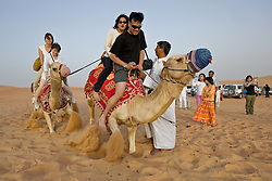 Camel riding is a popular tourist activity in the United Arab Emirates