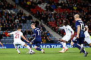 Scotland midfielder Gary Mackay-Steven (17) (Aberdeen) back heels the through ball to set up the goal for Scotland forward Steven Naismith (10) (Heart of Midlothian) during the Friendly international match between Scotland and Portugal at Hampden Park, Glasgow, United Kingdom on 14 October 2018.
