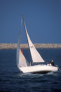 Sailing sailboat in channel, Port of Los Angeles, California
