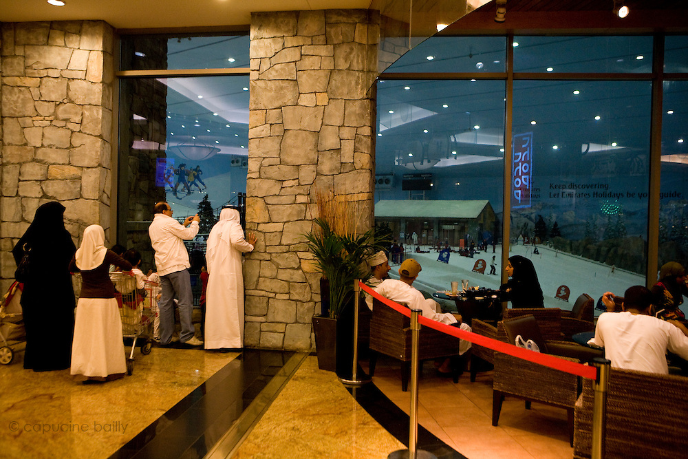 """Dubai, United Arab Emirates (UAE). January 30th 2009..Inside the Mall of the Emirates people watch """"Ski Dubai"""" through the windows..It's the first indoor ski resort in the Middle East and offers an amazing snow setting to enjoy skiing, snowboarding and tobogganing, or just playing in the snow all year round."""