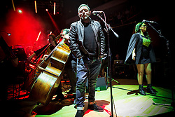 """© Licensed to London News Pictures . 05/02/2016 . Manchester , UK . SHAUN RYDER . """" Hacienda Classical """" debut at the Bridgewater Hall . The 70 piece Manchester Camerata and performers including New Order's Peter Hook , Shaun Ryder , Rowetta Idah , Bez and Hacienda DJs Graeme Park and Mike Pickering mixing live compositions . Photo credit : Joel Goodman/LNP"""