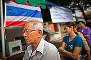 03 JULY 2011 - SAMUT PRAKAN, THAILAND:  Voters wait in line to vote in Samut Prakan, Thailand, Sunday, July 3. More than 47,000,000 Thais were registered to vote in Sunday's election, which had turned into a referendum on the current government, led, by the Thai Democrats and the oppositionPheu Thai party. Pheu Thai is the latest political incarnation of ousted Thai Prime Minister Thaksin Shinawatra. PT is led by his youngest sister, Yingluck Shinawatra, who is the party's candidate for Prime Minister. Exit polling by three Thai polling firms showed Pheu Thai winning a landslide election.       PHOTO BY JACK KURTZ