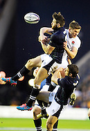 England's 12 tackled by Scotland's 11 during the Six Nations match between Scotland and England at Murrayfield Stadium, Edinburgh, Scotland on February  6th  2016.   AFP PHOTO / NEIL HANNA
