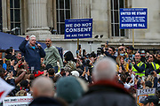 David Icke addresses the crowd of protestors during a 'We Do Not Consent' rally at Trafalgar Square, organised by Stop New Normal, to protest against coronavirus restrictions, in London on Saturday, Sept. 26, 2020. (VXP Photo/ Vudi Xhymshiti)