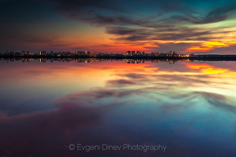 View to the city from Atanasovsko lake at sunset